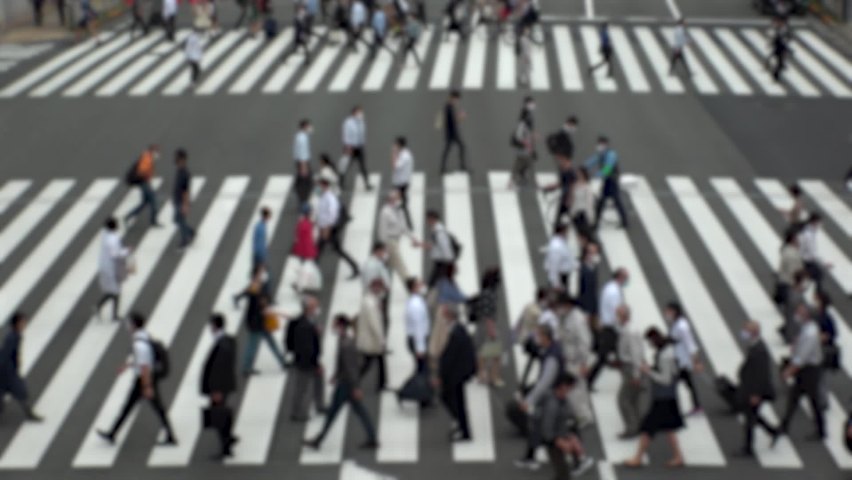TOKYO, JAPAN : Aerial high angle view of crowd of people walking at zebra crossing in rush hour. Commuters at the street. Japanese city lifestyle, business and work concept. Slow motion blurred shot. | Shutterstock HD Video #1066334332
