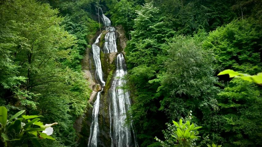 Beautiful flowing waterfalls in green forest. Tropical in mountain jungle 4K video footage background   Shutterstock HD Video #1066351570