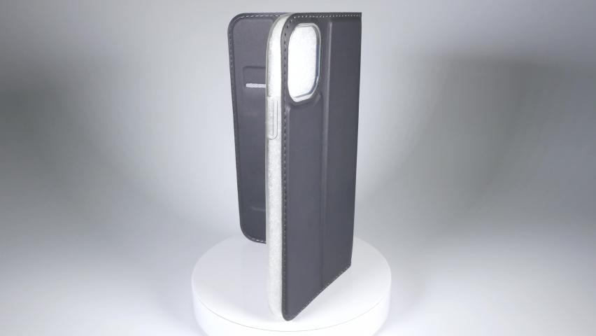 Smartphone case notebook type, close up video clip | Shutterstock HD Video #1066390678