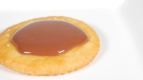 Round crackers with chocolate, close up video clip