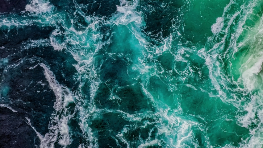Waves of water of the river and the sea meet each other during high tide and low tide. Whirlpools of the maelstrom of Saltstraumen, Nordland, Norway Royalty-Free Stock Footage #1066458541