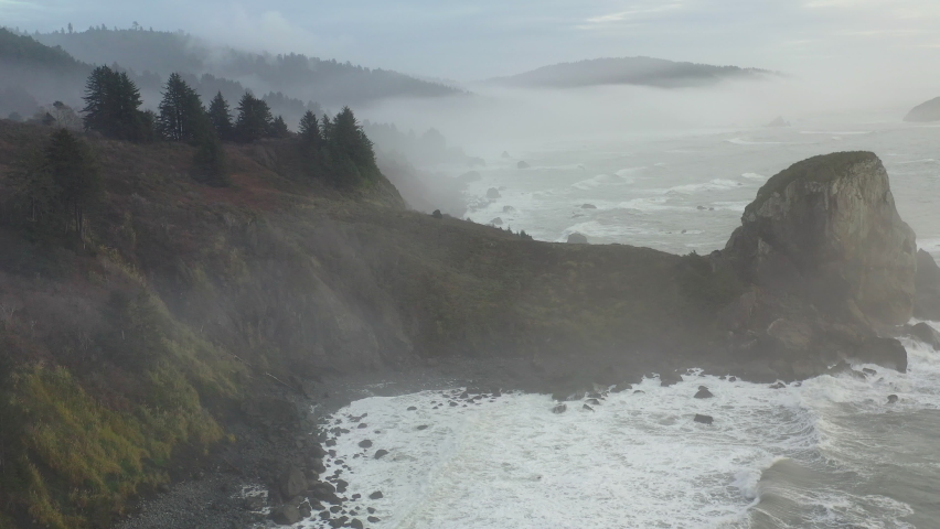 The Pacific Ocean washes against the beautiful and rugged Northern California coastline in Klamath. The scenic Pacific Coast Highway runs along this amazing part of the west coast. Royalty-Free Stock Footage #1066474081