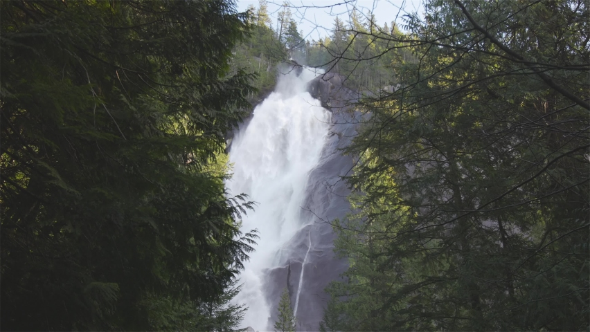 View of Shannon Falls and water rushing down the canyon during a sunny winter day. Located in Squamish, North of Vancouver, British Columbia, Canada. Nature Background Panorama. Slow Motion.