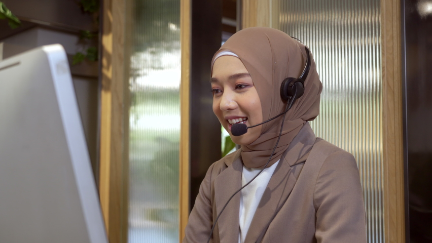 Beautiful asian muslim women wearing hijab working in call center office, Confident islam woman worker in Customer Support smiling joyful to Support Customers Royalty-Free Stock Footage #1066536721