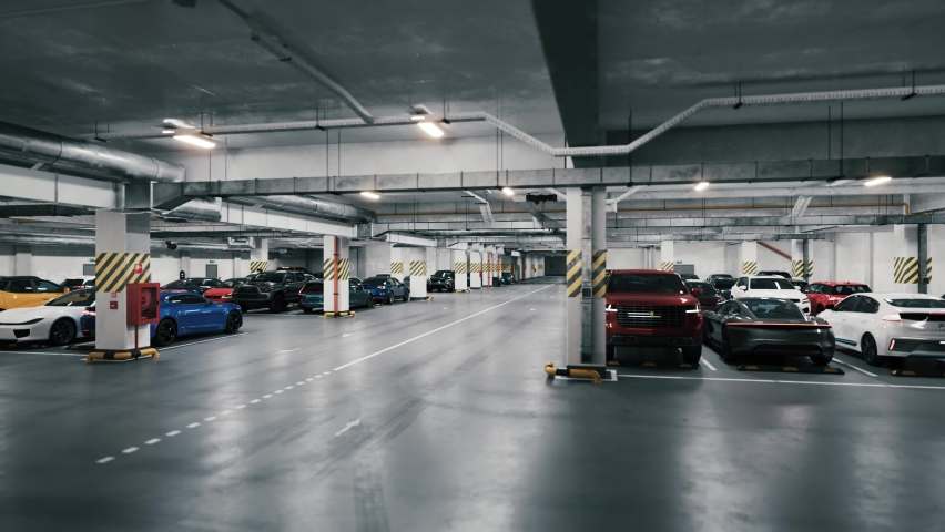 Underground parking with cars, time lapse. Underground parking with quickly cars coming. Many cars in parking garage. An underground parking garage filled with vehicles. Royalty-Free Stock Footage #1066548280