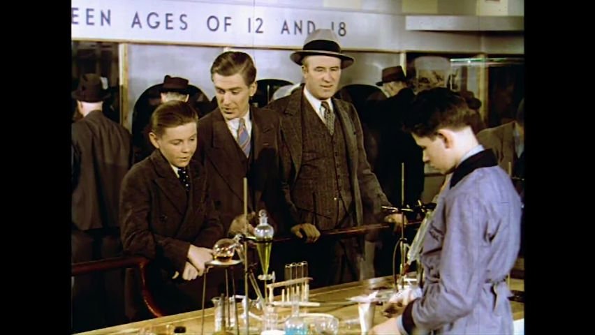 CIRCA 1930s - A young man hopes to inspire a disillusioned boy by showing him a teenaged chemist at work in a lab at the 1939 New York World's Fair.