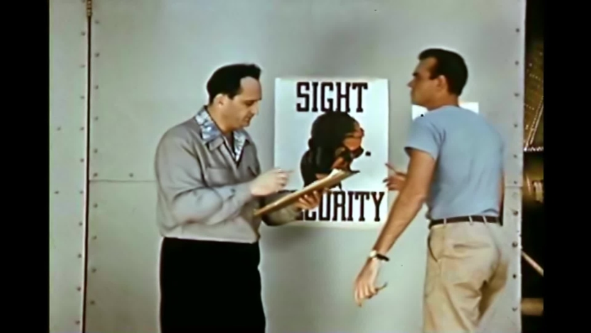 CIRCA 1950s - Dad tells his son and a school friend that the airplane factory he works at has a safety committee just like their school does. | Shutterstock HD Video #1066589038
