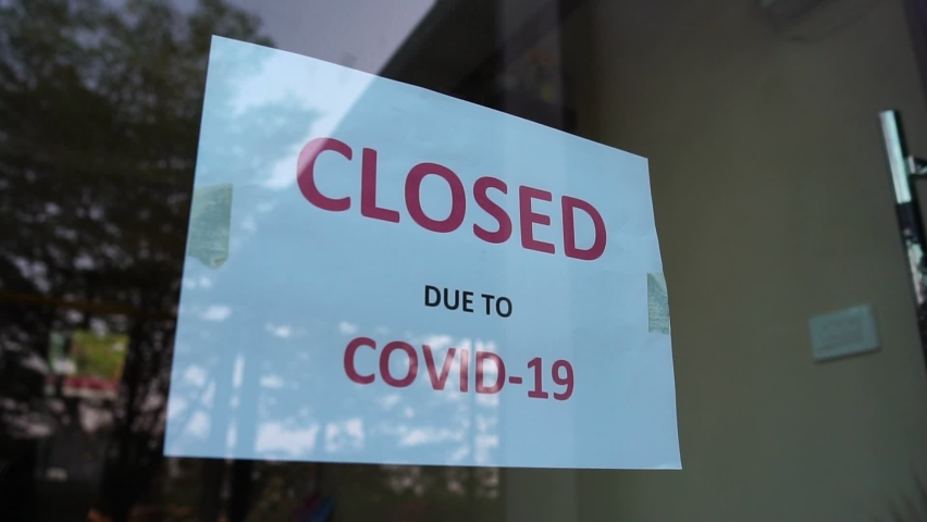 Footage Slow Motion: Closed sign on shop door Due to COVID-19  | Shutterstock HD Video #1066605592