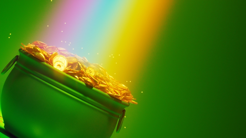 The magical rainbow that leads to the pot of gold. Irish symbol of luck, success and wealth. A green cauldron is full of golden coins. Leprechaun's treasure on a green background. St Patrick day. Rich   Shutterstock HD Video #1066661299