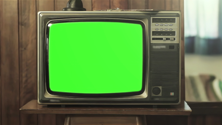 """Vintage Television Set with Green Screen Background. Zoom In. You can replace green screen with the footage or picture you want. You can do it with """"Keying"""" effect in After Effects. 4K Resolution. 
