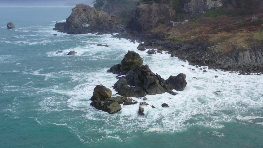 The cold, nutrient-filled waters of the Pacific Ocean crash on the rocky Northern California coastline in Humboldt. The scenic Pacific Coast Highway runs along this amazing part of the west coast. Royalty-Free Stock Footage #1066676719