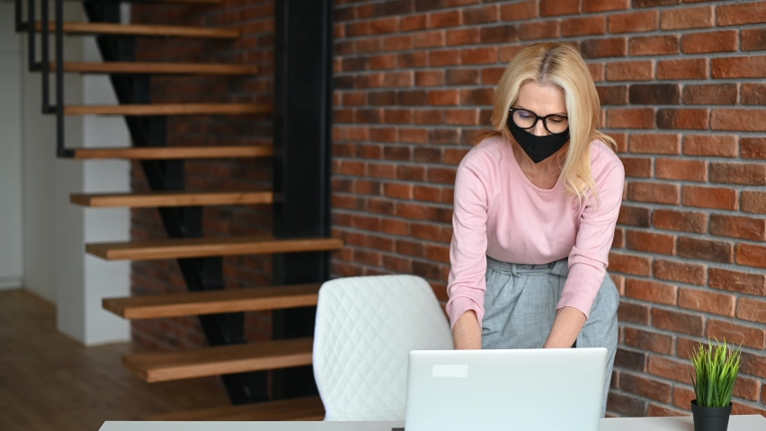 Greetings in the office during a pandemic, alternative handshake. Office employees in medical face masks greeting with elbow bump and smile to each other. Protective measures Royalty-Free Stock Footage #1066803910