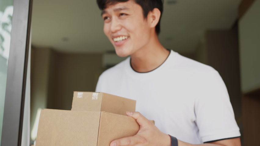 slow motion of asian man hand holding group of boxes while receiving form postman and say thank you for delivery business and transportation service concept Royalty-Free Stock Footage #1067054920