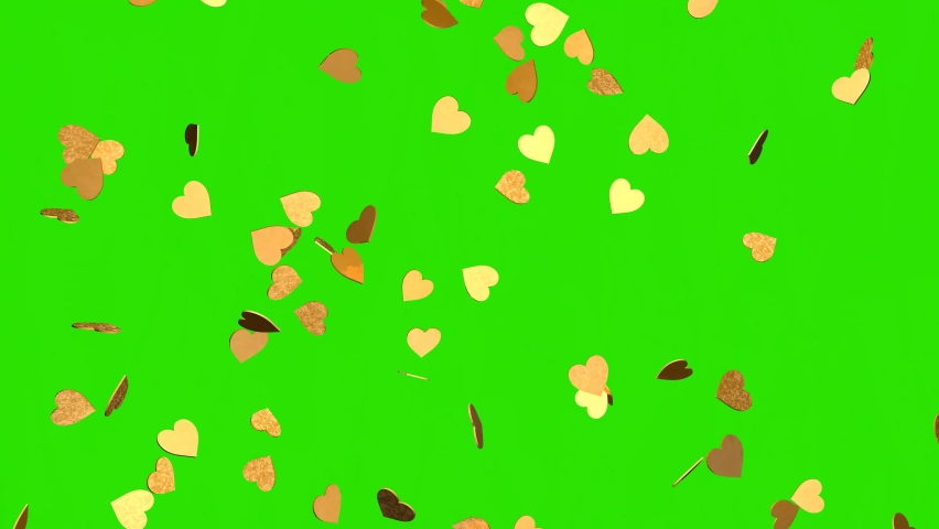 Falling gold hearts on a chroma key background. 3D rendering of animation. Video effect for valentine's day and weddings. Green screen. Rain from hearts. Royalty-Free Stock Footage #1067080345