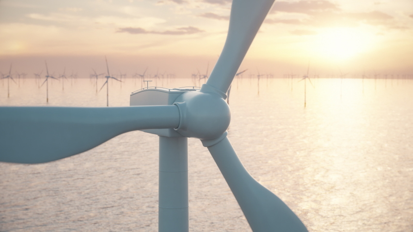 Camera moves around the head of a wind turbine to reveal an aerial view of a large wind farm in the sea against a low sun. Green and renewable energy concept. Realistic high quality 3d animation. Royalty-Free Stock Footage #1067083231