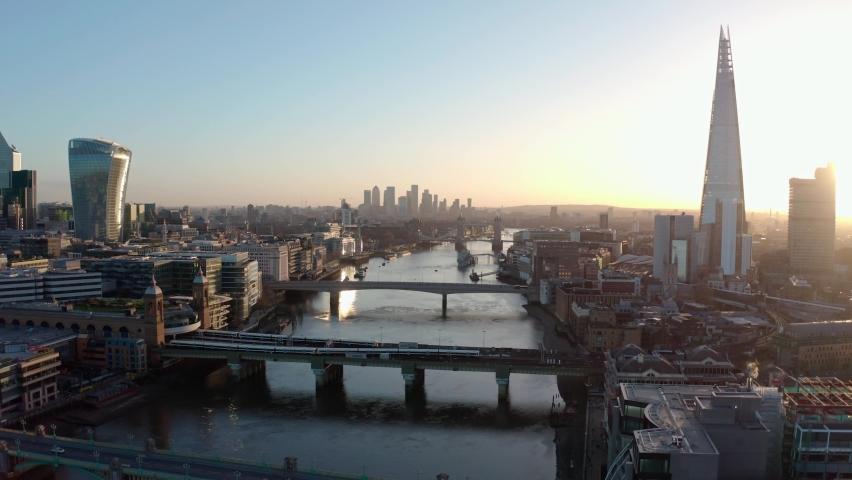 Establishing Aerial drone dolly back shot of thames river London city centre sunrise | Shutterstock HD Video #1067159746