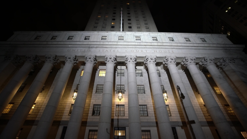 Manhattan, New York,USA - November 5. 2019: Epic View of New York Courthouse at Night, illuminated front of Building in NYC. United States Courthouse Building
