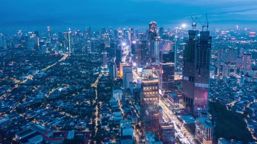 Stunning City View of Futuristic Skyline at Night, Skyscrapers in Asian Indonesian Capital Jakarta with flashing lights and Car Traffic Flow on Main road, Aerial Hyperlapse Time Lapse, Drone View   Shutterstock HD Video #1067203771