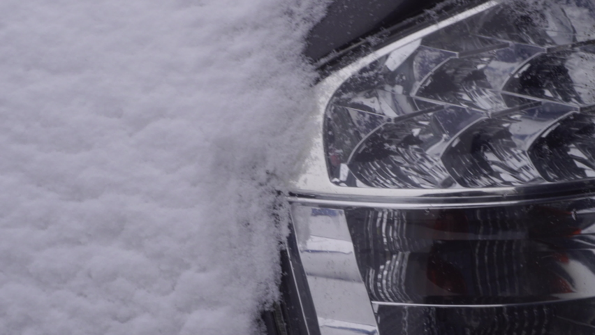 Car covered by snow after a snow blizzard. Winter city