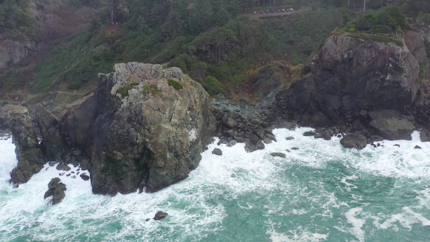 The cold, nutrient-filled waters of the Pacific Ocean wash against the rocky Northern California coastline in Humboldt. The scenic Pacific Coast Highway runs along this amazing part of the west coast. Royalty-Free Stock Footage #1067249326