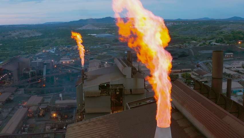 Pollution. Climate Change. Environmental damage.Gas flare stack burning off dangerous gases from a mine Royalty-Free Stock Footage #1067262106