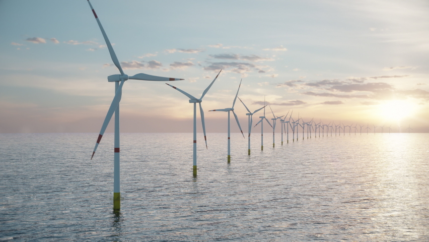Camera pulls back to show an aerial view of a long row of offshore wind turbines in the sea against low sun. Green and renewable energy concept. Realistic high quality 3d animation. Royalty-Free Stock Footage #1067268409