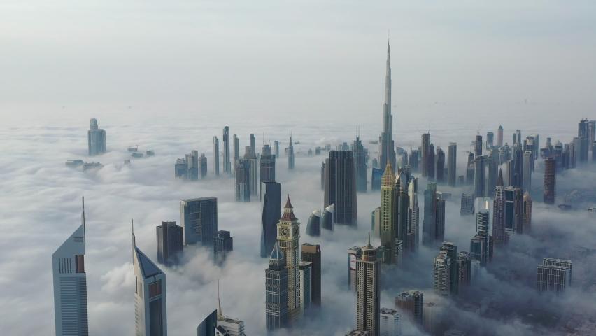 Aerial birds eye view of Dubai city urban futuristic skyline during fog