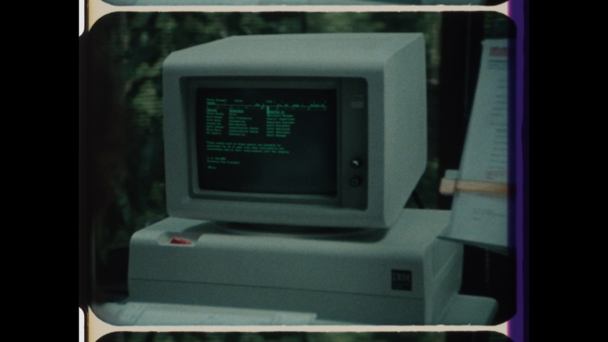1980s Armonk, NY. Vintage Computer Technology, Rapid Montage of Fingers Typing on Keyboard, Zoom in On IBM Computer, Women working on Desktop Computers. 4K Overscan of 16mm Archival Film Print