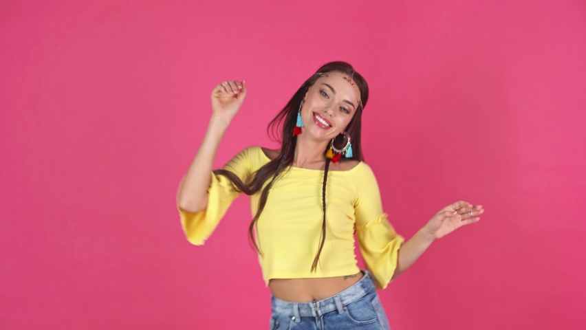 Studio shoot of happy young woman dancing isolated on crimson | Shutterstock HD Video #1067350897