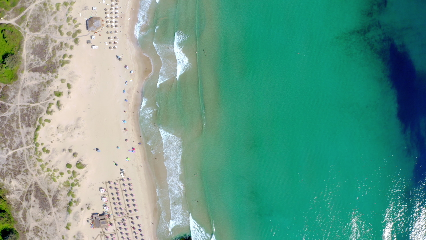 Aerial footage of the Bulgarian Black sea in Primorsko showing a drone top down view of a beautiful sandy beach with beach parasols   Shutterstock HD Video #1067369504