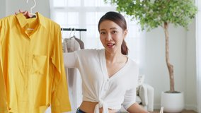 POV Asian woman influencer seller broadcast live streaming to sell clothes for online social marketing