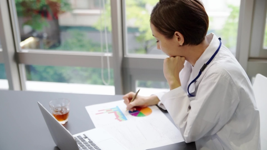 Female doctor working on a computer (conversation) Royalty-Free Stock Footage #1067429471