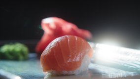 Serve nigiri sushi with salmon on a spinning platter. Japanese traditional cuisine. Slow motion 4K video