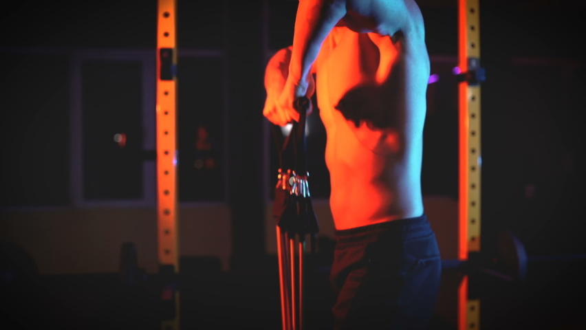 Shirtless male bodybuilder workout using resistance bands in the gym Royalty-Free Stock Footage #1067448185