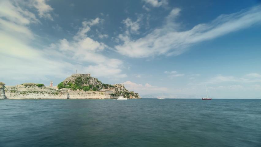 Corfu Town, Greece: View of Old Venetian Fortress in Corfu Island. Landscape panorama, time-lapse, ancient, fort, corfu, island, blue sky, sea. Time Lapse Video 4K   Shutterstock HD Video #1067454398