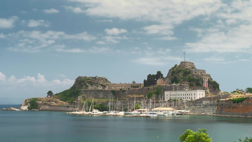 Corfu Town, Greece: View of Old Venetian Fortress in Corfu Island. Landscape panorama, time-lapse, ancient, fort, corfu, island, blue sky, sea. Time Lapse Video 4K   Shutterstock HD Video #1067454401