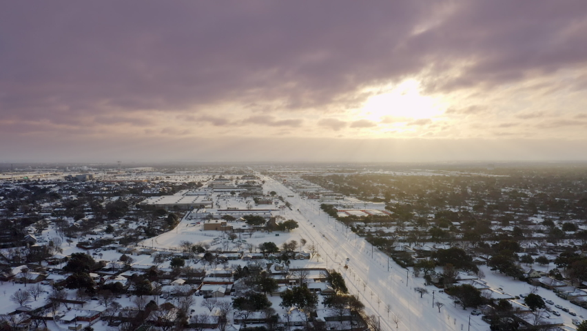 Aerial Tracking Shot of Snow Blanketing Suburbs of Dallas During Historic Winter Storm