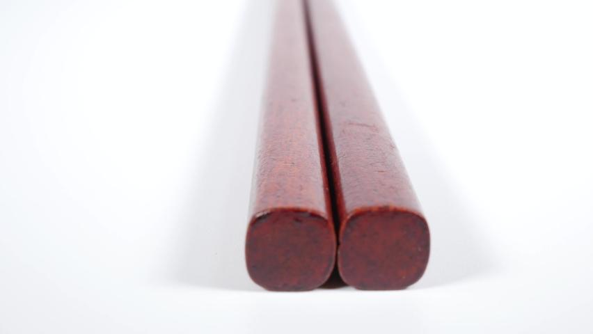 Wooden chopsticks, close up video clip | Shutterstock HD Video #1067473457
