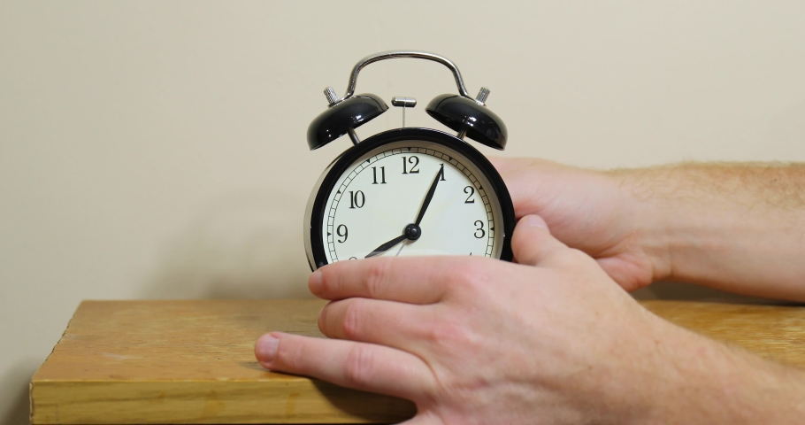 Setting clock back by one hour for ending summer daylight saving time in the autumn in October Royalty-Free Stock Footage #1067498108