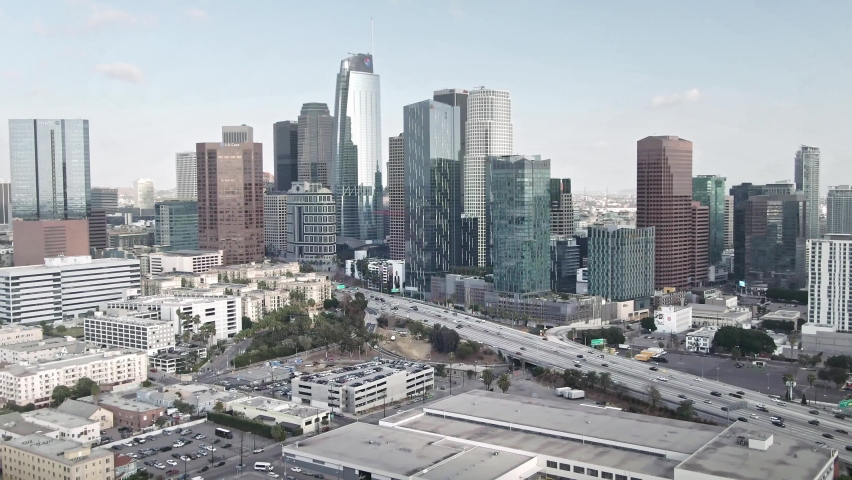 LOS ANGELES, CA, USA - Feb 15, 2021: Drone 4k. Los Angeles aerial view. Cars on highway roads. modern office buildings, skyscrapers, banks, downtown apartments in LA. Urban life, city in USA.