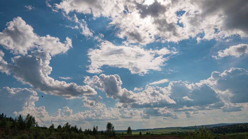 White clouds, clear soft sky, time lapse formating cloudscape in horizon, rainy rolling fast moving, beautiful summer sunny day, colourful weather. Royalty-Free Stock Footage #1067560019