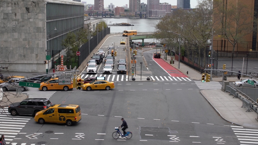 Manhattan, New York,USA - November 7. 2019: traffic on 1st Avenue and 42nd Street next to united Nations. heavy Traffic entering City on New York. Yellow taxi Cabs and Cars