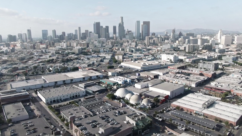 LOS ANGELES, CA, USA - Feb 15, 2021: Los Angeles Drone 4k. Aerial view of warehouses, office buildings, skyscrapers, downtown apartments in LA. Urban life, arts and fashion district of LA.