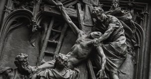 Statues on main entrance door of Duomo di Milano,main christian catholic church in Italy.Popular tourist landmark on Piazza di Duomo in center of Milan,filmed in close up video