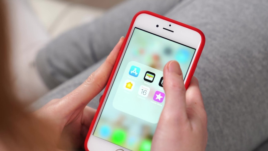 Tiktok. phone in hand. installing a app on a smartphone. service for creating and viewing short videos. free apps for iPhone. Russia, Rostov-on-Don, 17.02.2021 | Shutterstock HD Video #1067784284