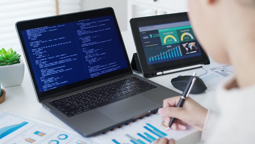 Back rear view of young asian woman, freelance data scientist work remotely at home coding programing on Big data mining, AI data engineering, IT Technician Works on Artificial Intelligence Project. Royalty-Free Stock Footage #1067806712