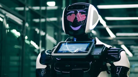 Robotic technology, innovation concept. Bionic robot is being cheerful and having heart-eyes
