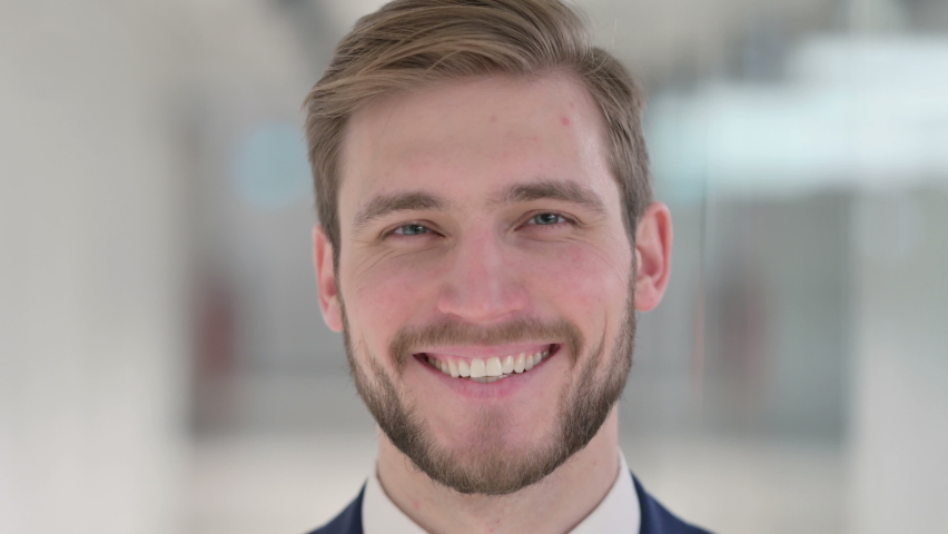 Close up of Face of Young Businessman Smiling at the Camera    Shutterstock HD Video #1067985755
