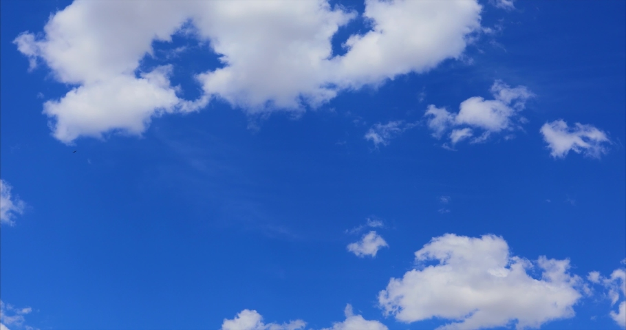 beautiful cloud Blue sky Time lapse clouds 4k rolling puffy cumulus cloud Royalty-Free Stock Footage #1068007538