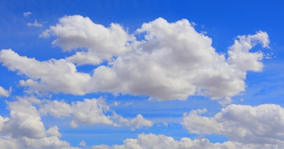 beautiful cloud Blue sky Time lapse clouds 4k rolling puffy cumulus cloud Royalty-Free Stock Footage #1068007541